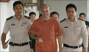 It's no wonder Christopher Neil is smiling after sentencing in Thailand